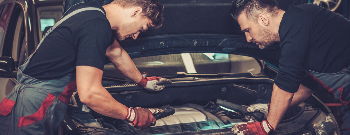 Mechanics working on vehicle - Car Servicing Crossways, Weymouth